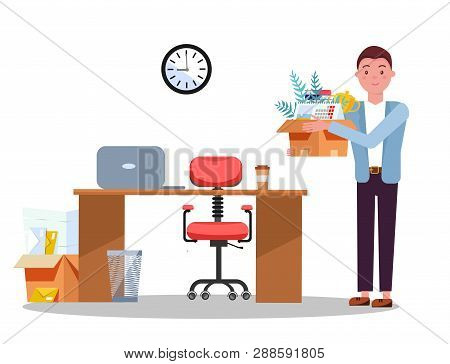 Successful Smiling Young Business Man Holding Cardboard Box With Work Stuff At A New Workplace With