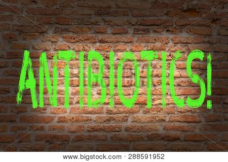 Word writing text Antibiotics. Business concept for Antibacterial Drug Disinfectant Aseptic Sterilizing Sanitary Brick Wall art like Graffiti motivational call written on the wall. poster