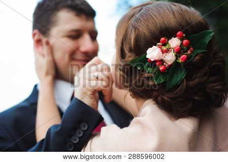 Romantic Embrace Of Newlyweds. Couple Walks In The Park