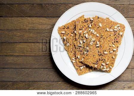 Vegan Dehydrated Raw Bread Loaves On White Dish On Wooden Table