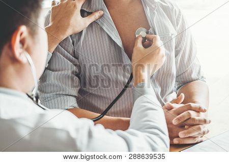Doctor Measuring Arterial Blood Pressure Man Patient Health Care In Hospital
