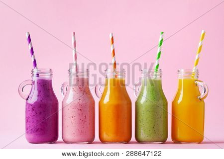 Summer Colorful Fruit Smoothies In Jars On Pink Background. Healthy, Detox And Diet Food Concept.
