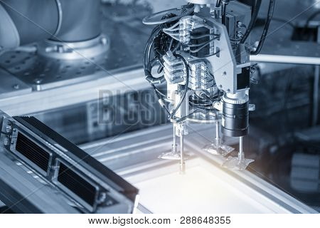 The Robotic Arm Use In Electronics Production Line With The Lighting Effect.the Hi-technology Electr