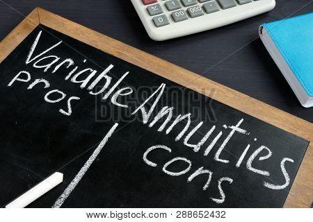 Variable Annuities pros and cons written on a blackboard. poster