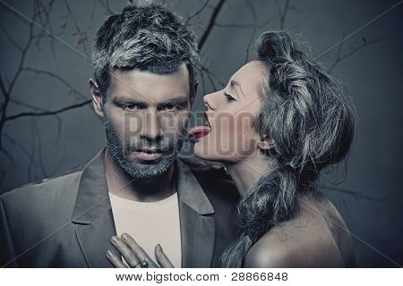Woman licking man's cheek