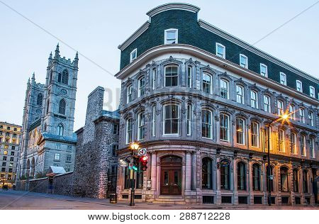Montreal, Canada - October 20, 2018. Notre Dame Basilica, Streets And Historical Buildings In The Hi