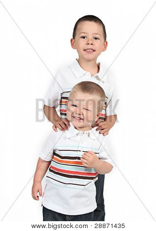 little Brothers standing together on white background