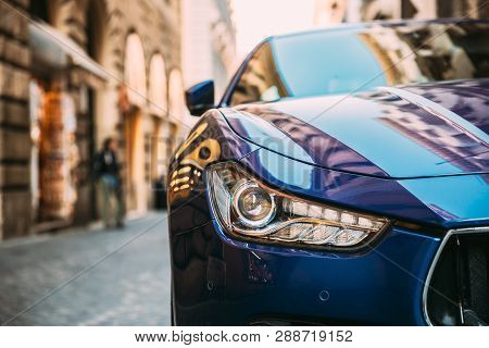 Rome, Italy - October 20, 2018: Close Up Headlight Of Blue Color Maserati Ghibli M157 Car Parked At