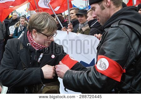 Moscow, Russia - March 10, 2019.political Rally For A Free Internet. National Bolshevik Ties A Red A