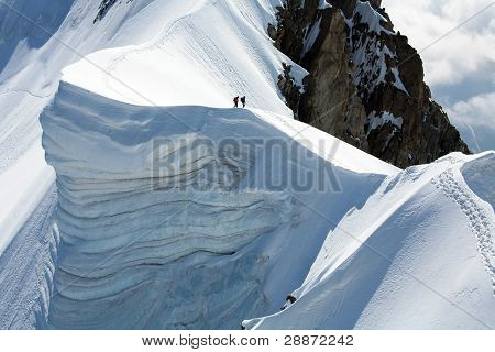 Team of two alpinists on Rochefort Ridge, France poster