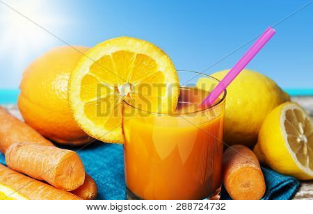 Carrot, Orange And Lemon Juice. Healthy And Refreshing Fruity Summer Drink Front View Closeup On A W