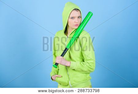 Girl Troublemaker. Woman Play Baseball Game Or Going To Beat Someone. Girl Hooded Jacket Hold Baseba