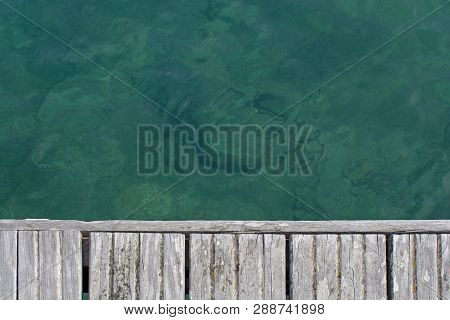 Emerald Green Water And Wood Boardwalk Background Texture