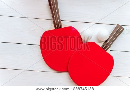 Red Racket For Ping Pong Ball Wooden Background Top View