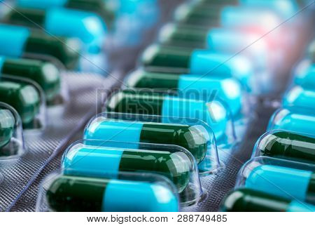 Closeup Green-blue Antibiotic Capsule Pills In Blister Pack. Antimicrobial Drug Resistance. Pharmace