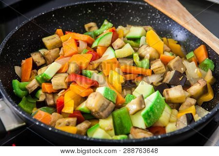 Mix Of Fresh Grilled Vegetables On Black Pan With Soya Sauce