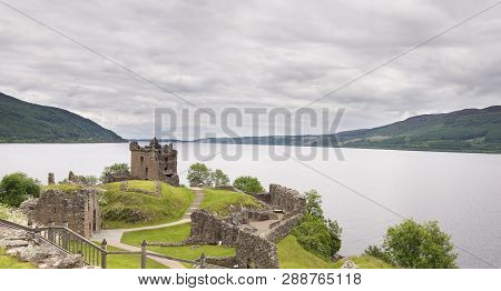Urquhart Castle On Loch Ness Landscape On A Grey Cloudy Day