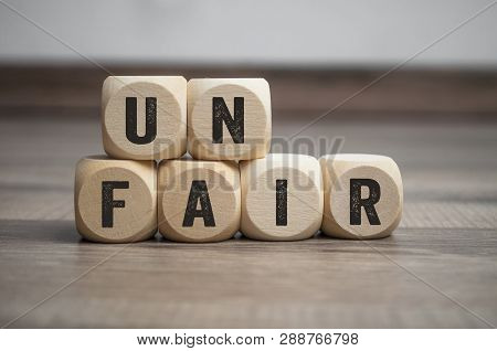 Cubes Dice On Wooden Background With Unfair