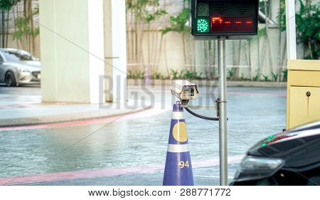 Security Equipment Concept - Cctv Camera Surveillance On Car Parking Safety System Area Control With