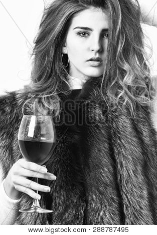 Girl Enjoy Luxury Lifestyle Attributes. Fashion Model Long Hair Fur Coat Or Vest Hold Wineglass. Wom
