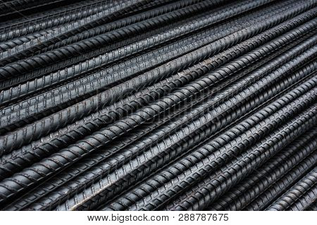 Rebars For Reinforcement Concrete Structure In The Construction Site. And Rusty Surface On Steel