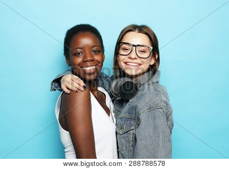 Shot of happy interracial homosexual couple hugging.African-American girl and her charming Caucasian girlfriend. People and relationship concept.