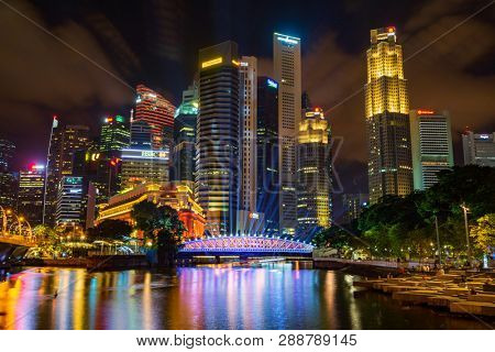 Singapore, Singapore - FEBRUARY 3, 2019: View at Singapore City Skyline during the ilight show , which is the iconic landmarks of Singapore
