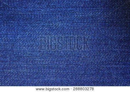 Jeans Dark Navy Blue Denim Fabric Texture Background. Classic Blue Jean Cloth Empty Canvas, Seamless