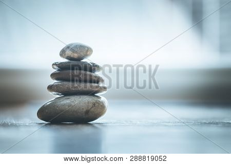 Feng Shui: Zen Stones On The Wooden Floor, Bright Light Is Coming Through The Window