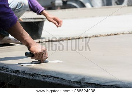 Plasterer Concrete Cement Work. Using A Trowel To Smooth Or Leveling Concrete Slab Floor Work Step O