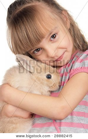 Easter concept image. Portrait of happy little girl with adorable rabbit over white background. poster