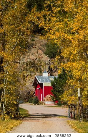 Country Barn And Rural Road In Autumn