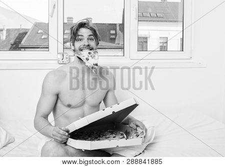 Man Bearded Handsome Eat Pizza. Man Eat Pizza Breakfast. Sexy Courier Delivers Gastronomic Satisfact