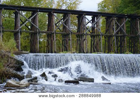 Historic Trestle Bridge Spans Rabbit River Above Dam In Hamilton Michigan