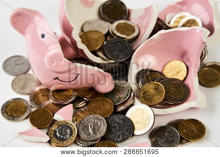 Broken Piggy Bank With Coins Money Isolated On White Background, Close-up