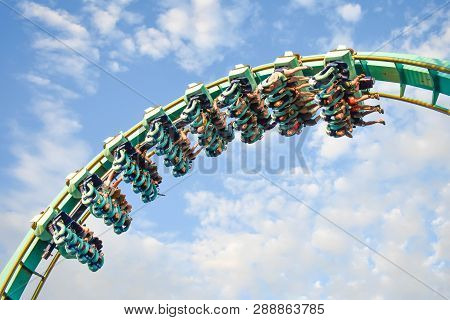 Orlando, Florida. January 20, 2019 People Having Fun Kraken Rollercoaster At Seaworld Marine Theme P