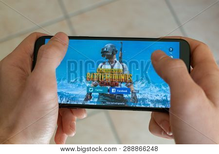 Italy, Roma - 7 March 2019: Hands Holding A Smartphone With Pubg Battlegrounds Mobile Game On Displa