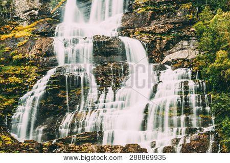 Beautiful Famous Tvindefossen Waterfall In Norway. Norwegian Nature Landscape At Summer. Waterfall T