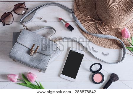 Woman Accessories With Make Up, Cosmetics, Brush And Smart Phone On White Wooden Background, Top Vie