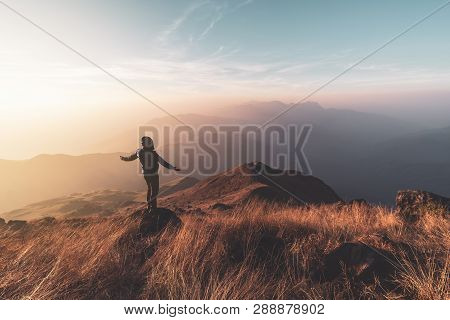 Young Man Traveler Looking Beautiful Landscape At Sunset On Mountain, Adventure Travel Lifestyle Con