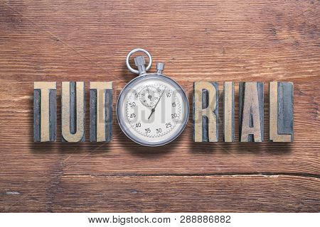 Tutorial Word Combined On Vintage Varnished Wooden Surface With Stopwatch Inside