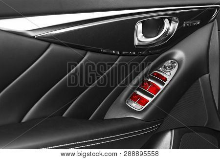 Door Handle With Red Power Window Control Buttons Of A Luxury Passenger Car. Black Perforated Leathe