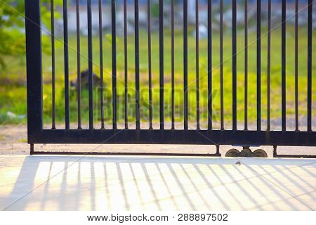 A Gate Of A House In The Morning,fence Iron, Metal Fence,shadows Of Metal Fence,metal Black Gate