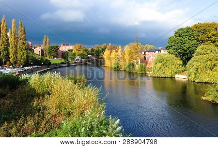 The River Severn Passing Through Shrewsbury In Shropshire, England. Photographed During A Sunny Peri