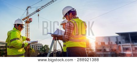 Construction Engineers Discussion With Architects At Construction Site Or Building Site Of Highrise