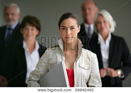An intern posing with her superiors