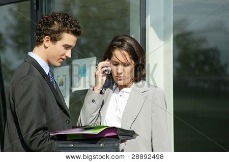 Businesscouple stood outside building