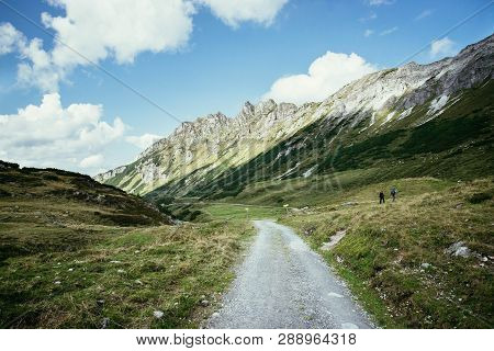 Hiking In The Austrian Mountains: Hiking Trail, Mountain Range And Blue Sky