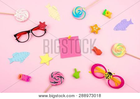 April Fools' Day Celebration Background With Paper Fish, Sticky Note And Decor On Pink Background. A