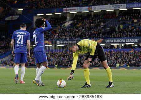 LONDON, ENGLAND - MARCH 7 2019: Referee Slavko Vincic spray marks the free kick spot during the Europa League match between Chelsea and Dynamo Kyiv at Stamford Bridge.